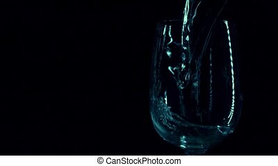 Super slow motion low light video of water being poured in a...