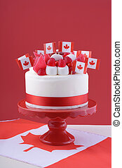 Happy Canada Day celebration cake with flags, marshmallow...