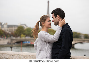 young couple in Paris kissing - young couple man and woman...