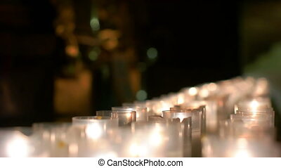 Row of Burning Candles Grouped Together - Detailed row of...