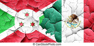 Burundi flag with Mexico flag on a grunge cracked wall