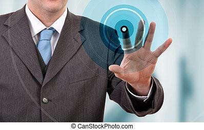 Touch screen - Businessman pressing a touchscreen button,...
