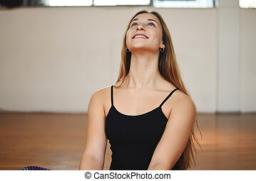 Portrait of an athlete young woman at gym Indoors