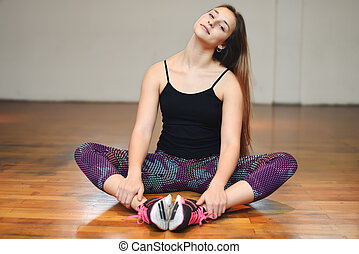 Athlete young woman doing exercise at gym Indoors -...