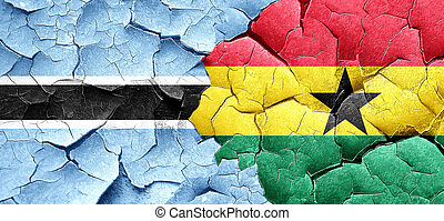 Botswana flag with Ghana flag on a grunge cracked wall