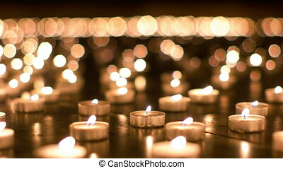 Detailed Shot of Burning Candles in the Church - Large group...