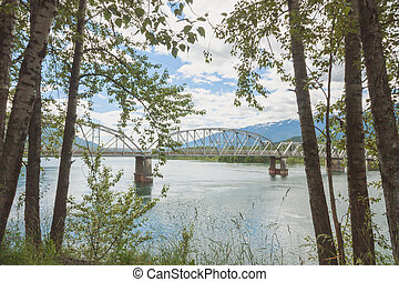 Tree Framed Big Eddy Bridge - Landscape of tree framed Big...