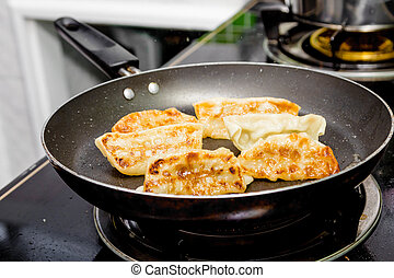 Gyoza (Japanese Dumplings)  in frying pan