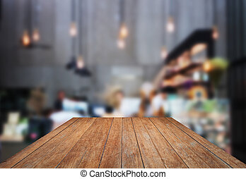 Perspective wooden with blurred background in coffee shop