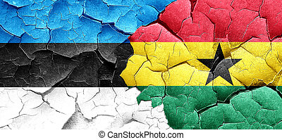 estonia flag with Ghana flag on a grunge cracked wall