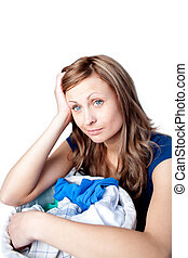 Displeased woman doing laundry isolated on a white...