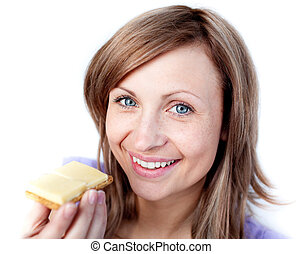 Beautiful woman eating a cracker with cheese isolated on a...