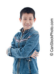 Young boy wearing trendy jeans jacket and crossed arms,,...