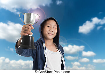 Low angle view of little boy celebrating victory while...