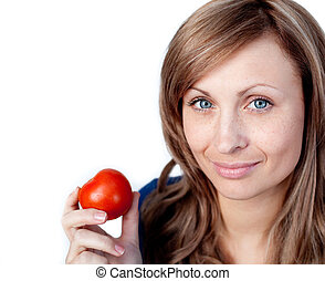 Attractive woman holding a tomato
