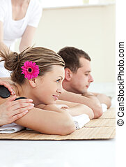Calm couple in an acupuncture therapy in a Spa center