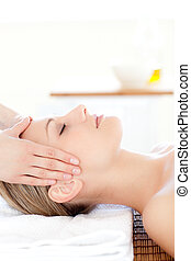 Close-up of a young woman receiving a head massage in s Spa...