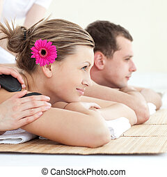 Close-up of a couple receiving a head massage in s Spa...