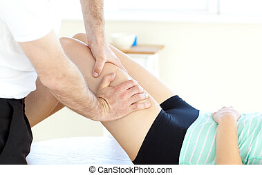 Confident woman exercising assited by her personal trainer...