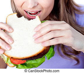 Close-up of a woman eating a sandwich
