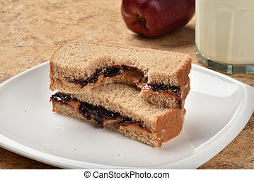 Peanut butter sandwich - A peanut butter sandwich with a...