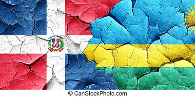 dominican republic flag with rwanda flag on a grunge cracked...