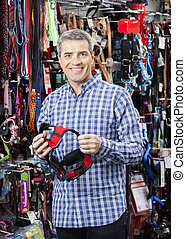 Customer Buying Belt From Pet Store - Portrait of happy...