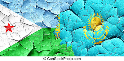 Djibouti flag with Kazakhstan flag on a grunge cracked wall