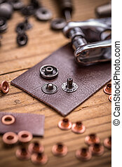 Leather and rivets - Tailor workplace with pieces of leather...