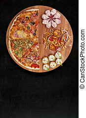 pizza and sushi - composition at plate by pizza and sushi...