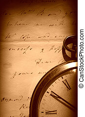 Vintage watch and old letter - Retro pocket watch on an old...