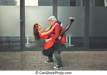 Couple the man and the woman dance. - The old man holds the...