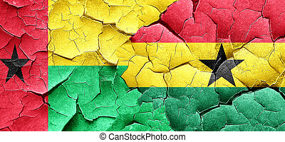 Guinea bissau flag with Ghana flag on a grunge cracked wall