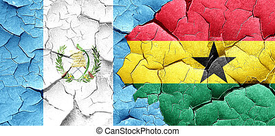 guatemala flag with Ghana flag on a grunge cracked wall
