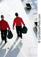 Taking out the garbage - Two men taking out the garbage.