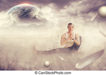 frau die yoga macht vor bergen und der erde im nebel fr ein...