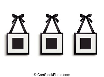 Blank photo frame hanging on ribbon