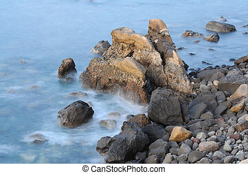 Waves going over rocks at the atlantic coast