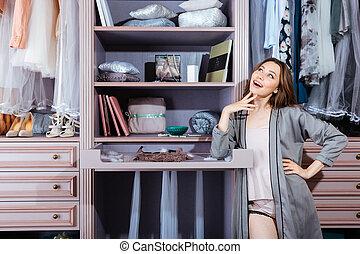 Beautiful young woman in her closet - Beautiful young...