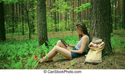Beautiful woman with tablet pc - Beautiful girl in the woods...
