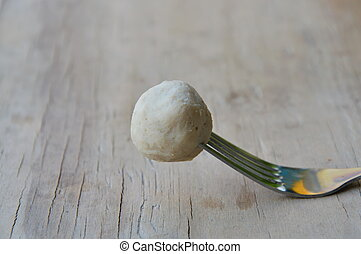pork ball stab in fork