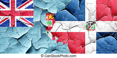 Fiji flag with Dominican Republic flag on a grunge cracked...