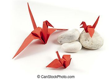 Red Origami Crane and his childres on white stones