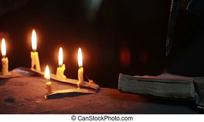 witch holding the magic ritual old book and candle halloween...