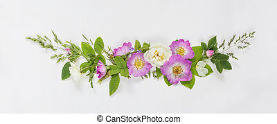 Decorative composition with wild rose flowers