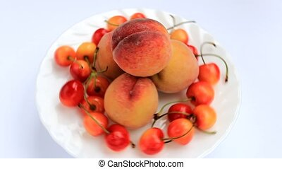 fresh peaches and cherries revolve