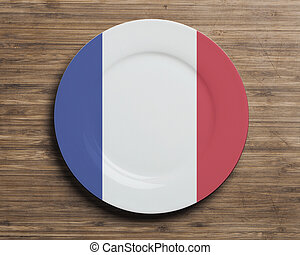 Plate on table with France flag - Plate on table with...