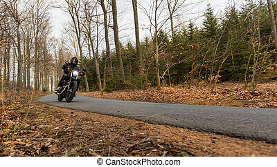 Man seat on the motorcycle on the road - Man seat on the...