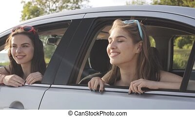 happy teenage girls or women in car at seaside 22 - summer...
