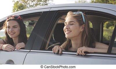 happy teenage girls or women in car at seaside 22 - summer...